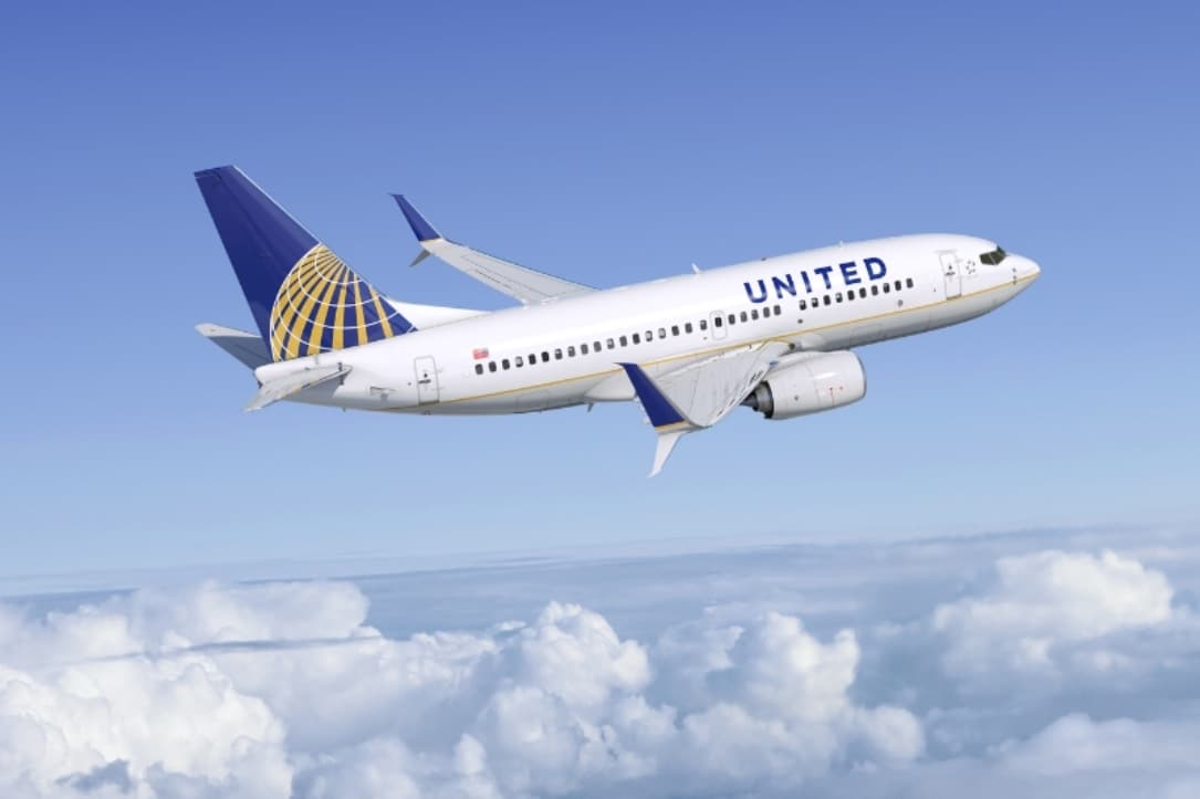 United scraps change fees